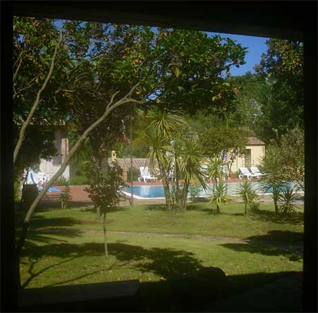 vire of the gounds and swimming pool from the master bedroom at the sardinia villa