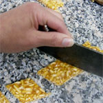 cutting the almond brittle into diamond shapes