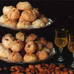 italian amaretti cookies with glass of strega