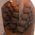 stack of wooden wine barrels