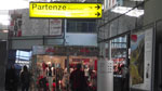 check in area at cagliari airport with departures sign