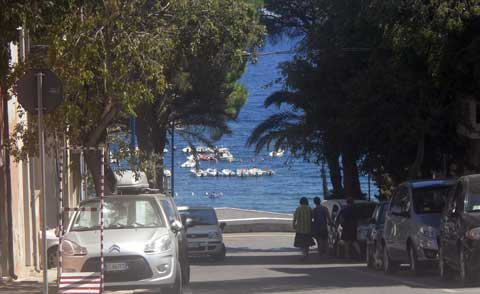 road that leads to the harbor in cala gonone