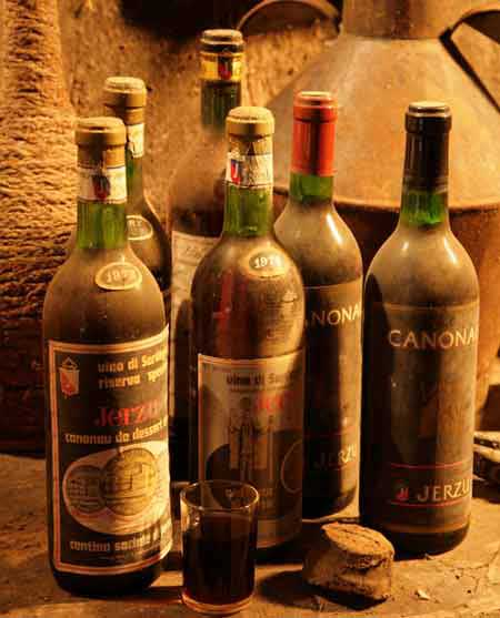 a collection of old cannonauwine bottles of wine