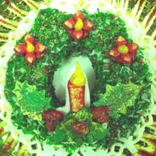 green coconut wreath cookie with candle and flowers