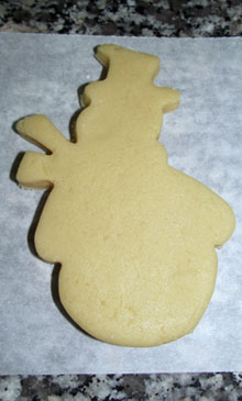 raw christmas snowman cut out cookie