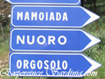 road sign indicating the ciyt of nuoro in sardinia
