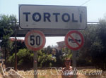 sign post of the town of tortoli near arbatax
