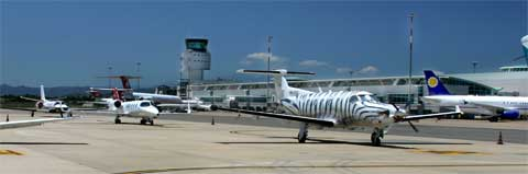 airplanes parked in alghero airport
