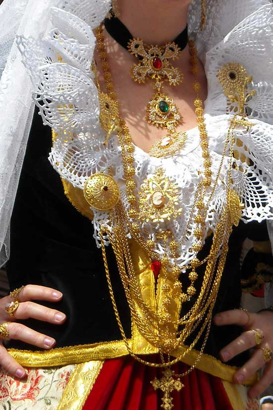 sardinian lady dressed in national costume showing of the gold filigree jewellery