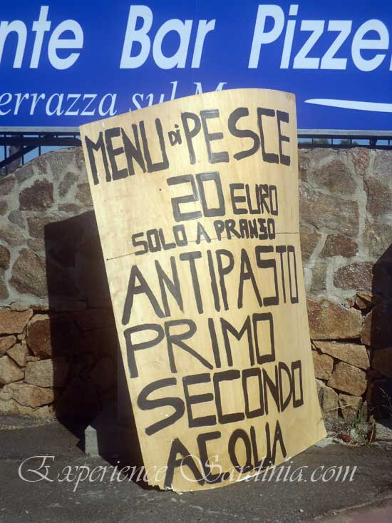 billboard showing prices of menu in cannigione sardinia