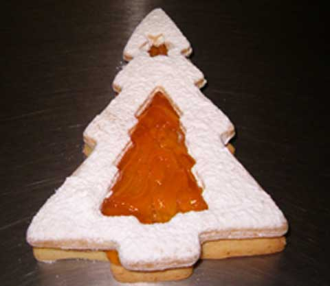 a jan sandwiched christmas tree cookie