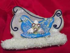 blue decorated santas sleigh cookies