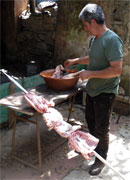 preparing the meat on the skewer