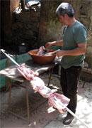 preparing the meat on the skewer