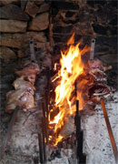 meat roasting on an open fire