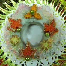 white chocolate wreath cookie with orange decorations