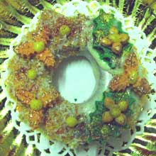 orange and green wreath cookie with coconut