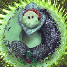 purple wreath cookie with santas face