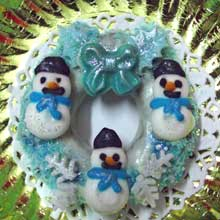 white and blue wreath cookies with mini snowmen
