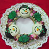 christmas wreath cookie decorated with snowman cookies