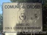 welcome sign post of the town of orosei in sardinia