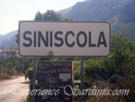 welcome sign post to the town of siniscola sardinia