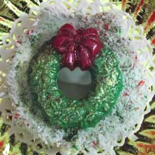 white coconut wreath cookie with green decoration