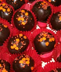 orange flavored almond ball coated in dark chocolate