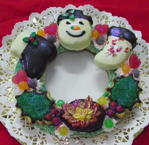 extra large wreath cookie with an assortment of christmas cookies on top