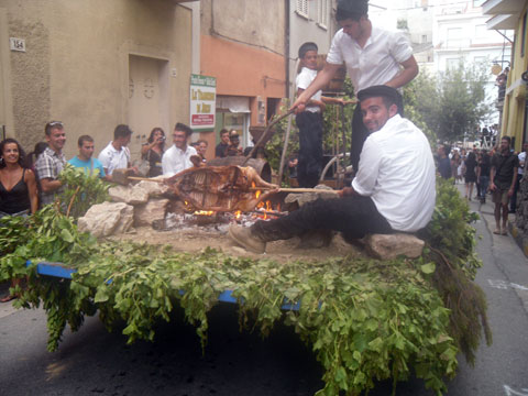 carnival float with an open fire roasting meat at the wine festival