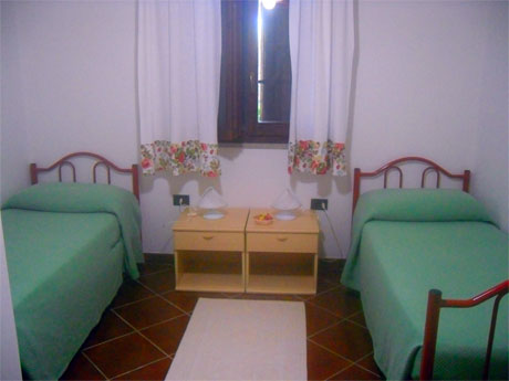 bedroom with two single besd in the villa apartment