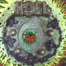 purple wreath cookie with chocolate molded noel